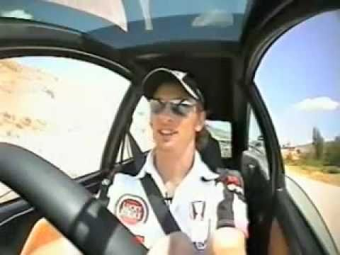 Jensen Button racing in Grand Prix